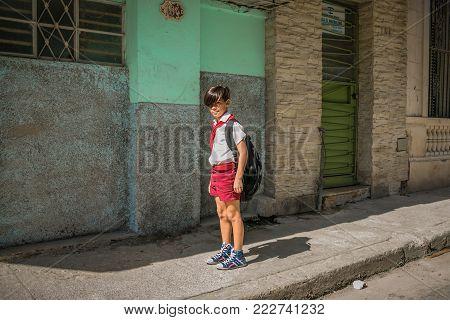 CUBA, HAVANA - 09 May 2017: little boy - pioneer in the street
