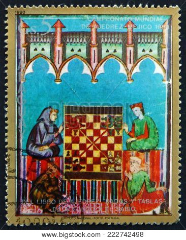 PARAGUAY - CIRCA 1980: a stamp printed in Paraguay shows Two Men and Chess Board, Illustration from the Book of Chess, 1980 World Chess Championships, Mexico, circa 1980