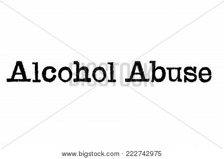 The word Alcohol Abuse from a typewriter on a white background