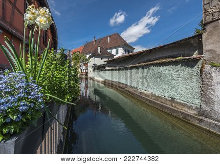 Colmar, France - May 2017: Along The Channel Of Little Venice Quarter On A Sunny Day