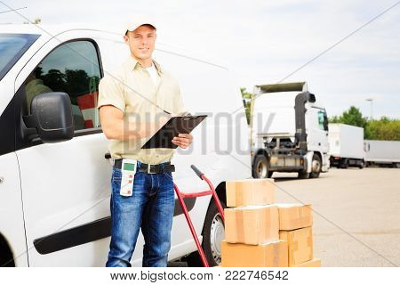a delivery person is standing next to his white van.