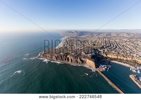 Aerial view of pacific ocean shoreline in Dana Point, California.