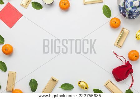 Flat lay of accessories Lunar New Year & Chinese New Year holiday background concept.Free space for mock up & template creative design text.Difference objects on modern rustic white paper at table.