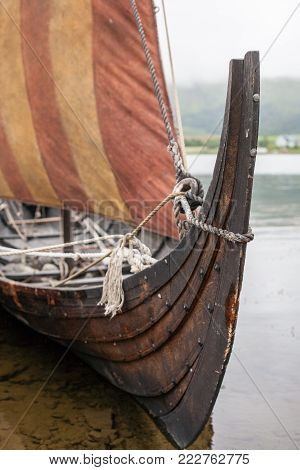 Drakkar dragon viking wooden boat with sail closeup