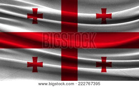 Realistic flag of Georgia on the wavy surface of fabric. This flag can be used in design