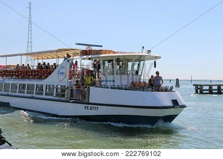 Venice, Italy - August 13, 2016: Passengers boat with tourists in the Adriatic Sea
