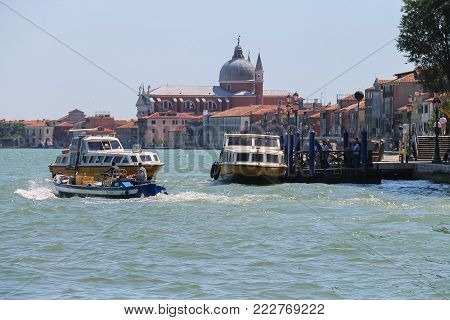Venice, Italy - August 13, 2016: Passengers boats with tourists near pier in the Adriatic Sea