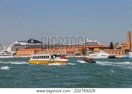 Venice, Italy - August 13, 2016: Big cruise liner ships and small tourist boats in the Adriatic Sea