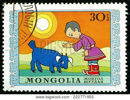 Ukraine - circa 2018: A postage stamp printed in Mongolia show Boy and disobedient bull calf. Series: International Childrens Day. Circa 1975