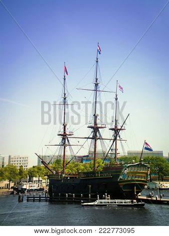 Amsterdam, Netherlands - Jule 3, 2015: Three-masted merchant ship. A merchant ship in the Amsterdam Canal