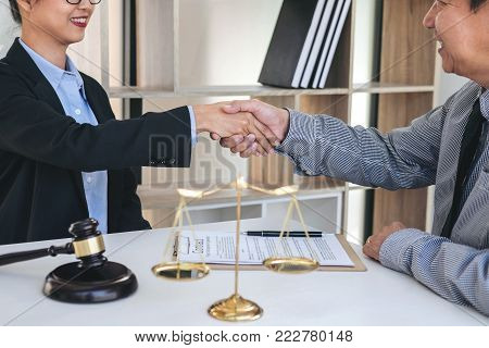 Having meeting with team at law firm, Consultation between a female lawyer and businesswoman customer, tax and the company of real estate concept, Handshake after good cooperation.
