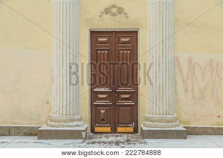 Vintage door in an old building in winter