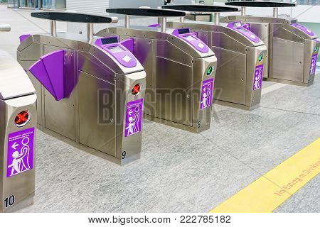 Automatic access control ticket barriers in subway station. View of barrier gate before access in to subway station. Automatic ticket barriers at subway entrance for train, railway, subway