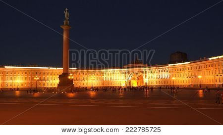 Saint-Petersburg, Russia - July 3, 2017: Tourists on the palace square at night. Saint-Petersburg, Russia