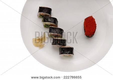 Isolated plate with sushi on the white background. Sushi with tuna, salmon, redfish. Plate with place for text. Japan cuisine.