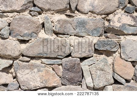 Natural Heavy Rocks And Bricks Wallpaper. Stones And Bricks Used For Construction And Natural Sand E