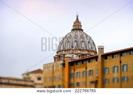 View of the dome of Saint Peter's Basilica or Basilica di San Pietro in Vatican city. Miniature effect.