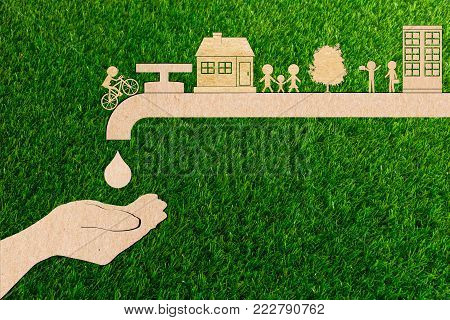 Droplet tap live water save ecology concept of paper cut tree green grass.