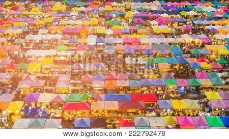 Top view night flea market roof top during weekend in Bangkok Thailand