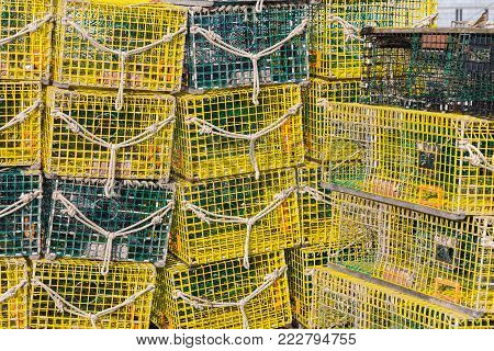 Full frame lobster traps stacked on top of each other.