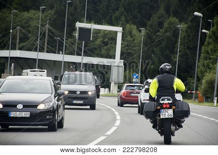 Austrian And Travelers People Driving Car And Riding Motorbike On The Road At Fussen City Go To Reut
