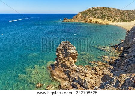 Beautiful Little Bay With Clear Turquoise Water And Rocks Around On Crete, Greece