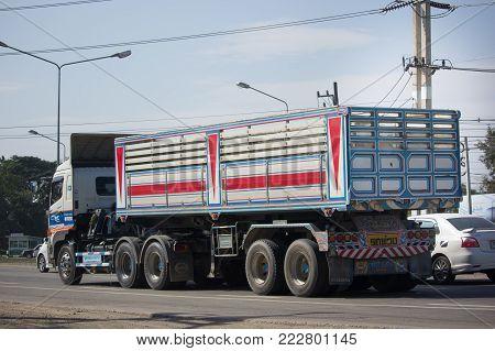CHIANG MAI, THAILAND -JANUARY 8 2018:  Trailer dump truck of Piboon Concrete. On road no.1001, 8 km from Chiangmai city.