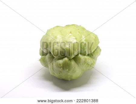 Chayote vegetable isolated on white. Exotic vegetable chayote studio photo. Green vegetable ingredient of mexican cuisine. Traditional Philippines food. Whole green chayote vegetable. Vegetarian food