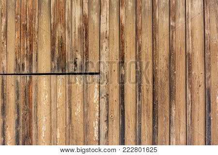 Background structure - Old door of barn with metal pieces.