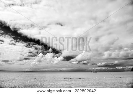 motorboat, yacht on sea, ocean water, coast with buoy sunny summer outdoor on blue cloudy sky background, traveling and vacation, sport and sailing