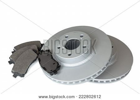 Brake discs and pads on a white background