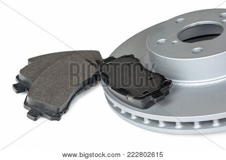 Brake disc and pads on a white background