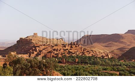 a typical berberian town from red clay on a slope of a hill in Atlas mountains in Morocco