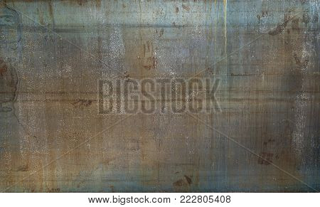 Old rusted metal sheet. Rusty surface caused by oxidation iron with blue and brown cracked color. For design work texture and background.