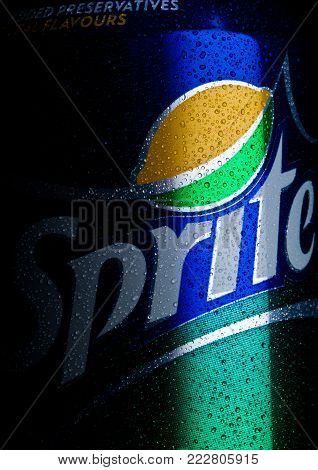 LONDON, UK - JANUARY 20, 2018: Aluminium can os Sprite on black background macro with dew.. Sprite is a colorless, lemon-lime flavored, caffeine-free soft drink, created by the Coca-Cola Company.