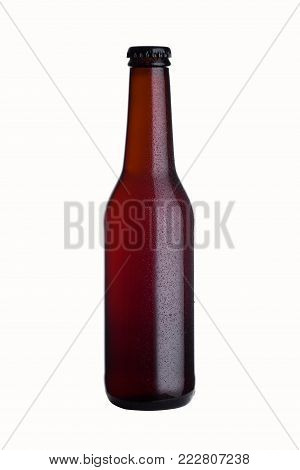Brown glass stout beer bottle with black cap isolated on white background with dew