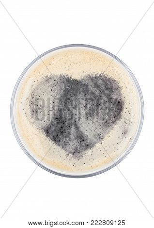 Glass of stout beer top with heart shape on white background top view