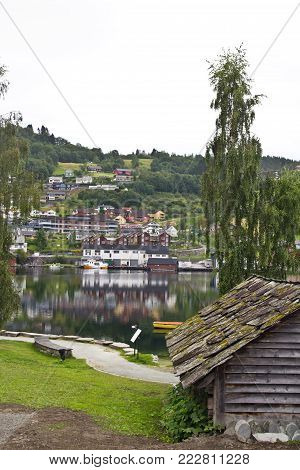 Summer view of Norheimsund village, located on the northern side of the Hardangerfjord, Norway. Evening scene in Norway, Hordaland. View from hotel window. Scandinavia traveling concept.