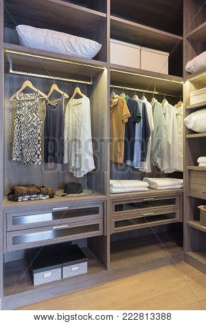 Wooden Wardrobe In Walk In Closet With Clothes