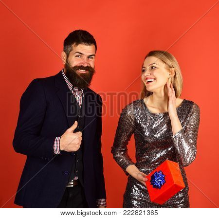 Couple In Love Shares Presents On Red Background.