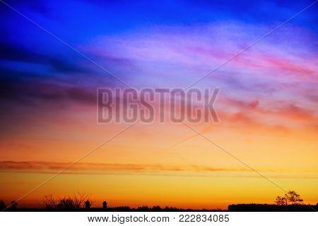 Beautiful bright sunrise at matutinal length of time in rural terrain