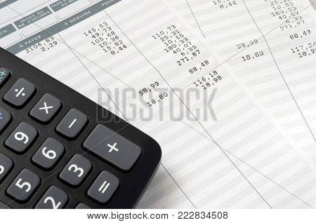 Pay slip and calculator, close up for payroll or salary background,