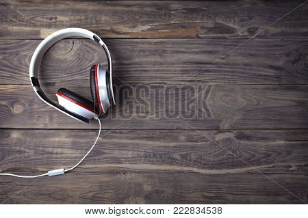 Headphone . headphone on wood table.  selective focus of headphone.Headset on a wood background .