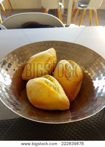 French Bread - Golden Rolls in a Metal Dish