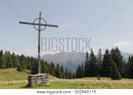 The Catholic wooden cross on the mountain