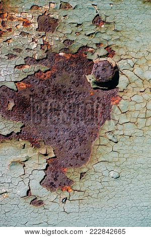 Sheet Of Rusty Metal With Cracked And Flaky Paint, A Metal Surface With A Bolt, Abstract Rusty Metal