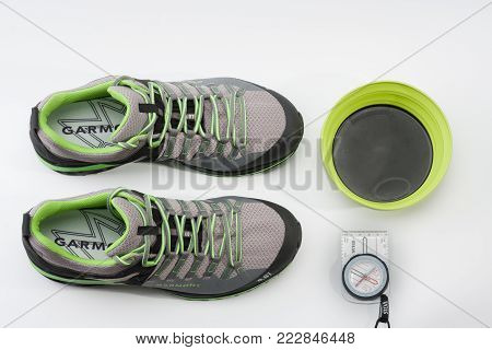 Brnenec, Czech Republic-July 9,2017: Men´s shoes Garmont 9.81 speed II for trail running, fast climbing, hiking, magnetic compass and silicone foldable plate  on white background.