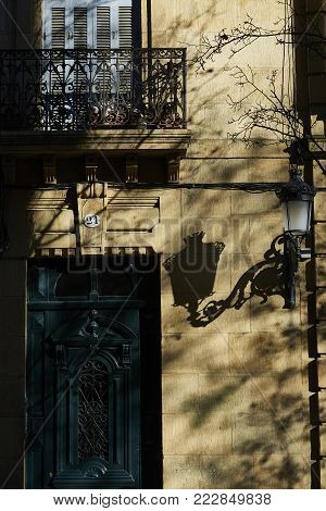 Antique Wooden Door In A European Street At Sunset.
