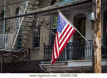 An American flag against some old architecture in Lambertville NJ.