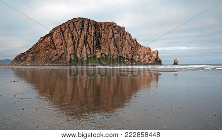 Morro Bay Rock at Sunrise at Morro Bay State Park popular vacation / camping spot on the Central California Coast United States